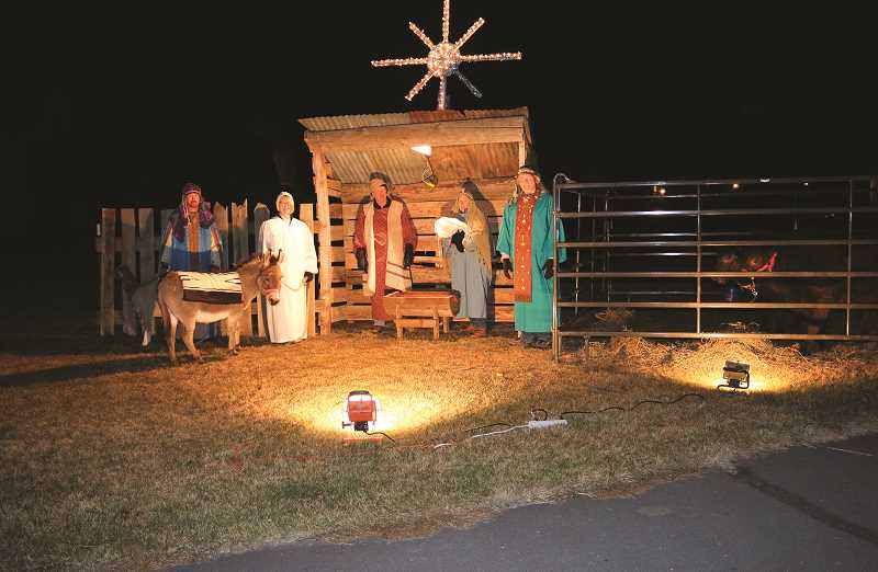 PHOTO SUBMITTED BY  TREY HINKLE - This year's drive-thru Nativity Scene at Powell Butte Christian Church campus will feature scenes that include a bustling and overcrowded inn, the quiet fields situated just outside of Bethlehem, a group of foreign astrologers traveling from far-off lands and a lowly stable where, on a silent night, the world would welcome its newborn Savior. The nativity scene is a free gift to the community by the congregants of Powell Butte Christian Church.
