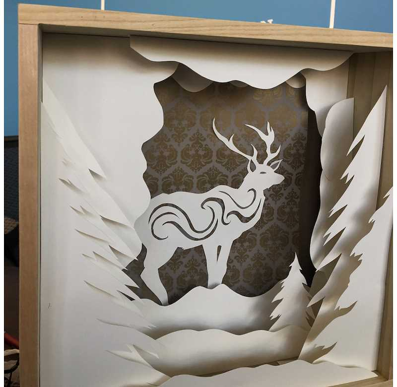 COURTESY PHOTO - Shea O'Brien's lightbox honoring a reindeer can be seen in downtown Oregon City at Modified Screen Printing.