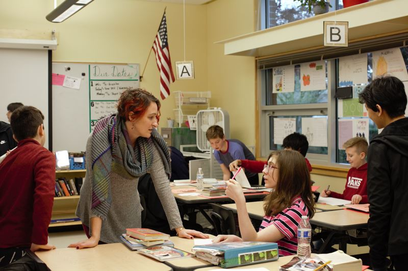 COURTESY PHOTO: ELIZABETH MILLER - Part of the 'Class of 2025' project, Ava (second from right) talks with language arts teacher Sadie Kenzler in the spring, before school closed down because of the COVID-19 pandemic.
