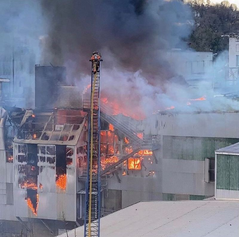 COURTESY CFD - Clackamas Fire District cews battle the Saturday blaze at the closed Blue Heron paper mill in Oregon City.