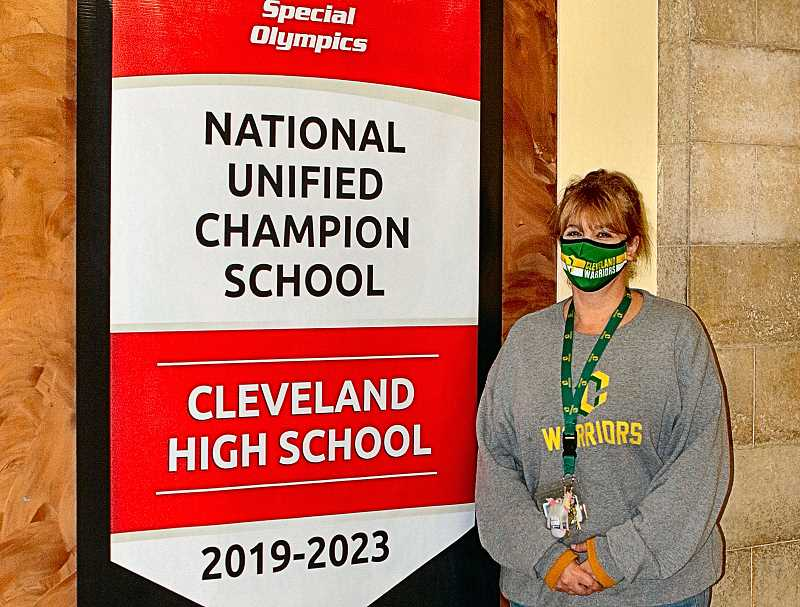 DAVID F. ASHTON - Heres CHS Special Education teacher Lurena Weesner, beaming with pride as she shows off Cleveland Highs new national Special Olympics award as a National Unified Champion School.