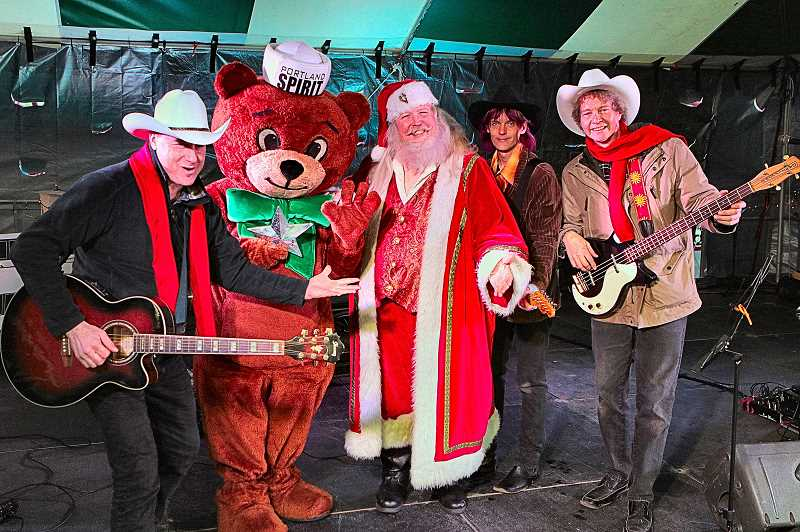 DAVID F. ASHTON - Its a fun time, when the Cocklebur Cowboys are joined by the Cinnamon Bear and Santa Claus - during the live drive-in family show at nonprofit Oaks Amusement Park, through New Years Eve.