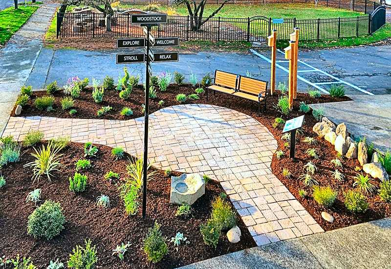 COURTESY OF ANGIE EVEN - Heres Woodstocks new pocket park, completed next to the sidewalk near the entrance to All Saints Episcopal Church. The lengthy project was finished after Angie Even and her husband Tim added their final touches to the parklet on Friday, November 20.
