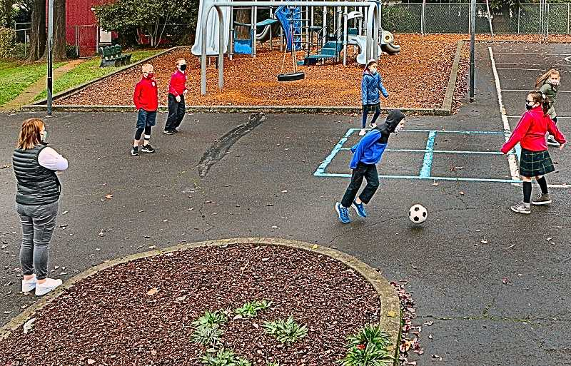DAVID F. ASHTON - The younger students who participate in on-campus learning, here enjoy recess, socially-distanced, in the playground of Holy Family Catholic School in Eastmoreland.