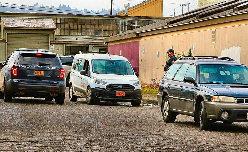DAVID F. ASHTON - A Portland Police Public Safety Support Specialist, in the white van, conferred with a Central Precinct officer, after having spotted and reported a recently-stolen car - with the suspected thief inside.