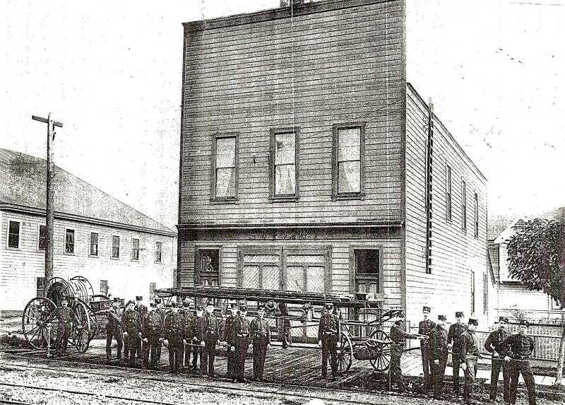 COURTESY OREGON HISTORICAL SOCIETY - This early 1900s picture shows Sellwood Volunteer Firefighters lined up by the fire equipment that they had to haul by hand through the unimproved streets of Sellwood. A few firefighters boasted a handlebar mustache - which some believed somehow filtered outthe smoke they had to inhale while fighting fires! The Sellwood Firehouse was on the corner of 13th Avenue and S.E. Tenino Street.
