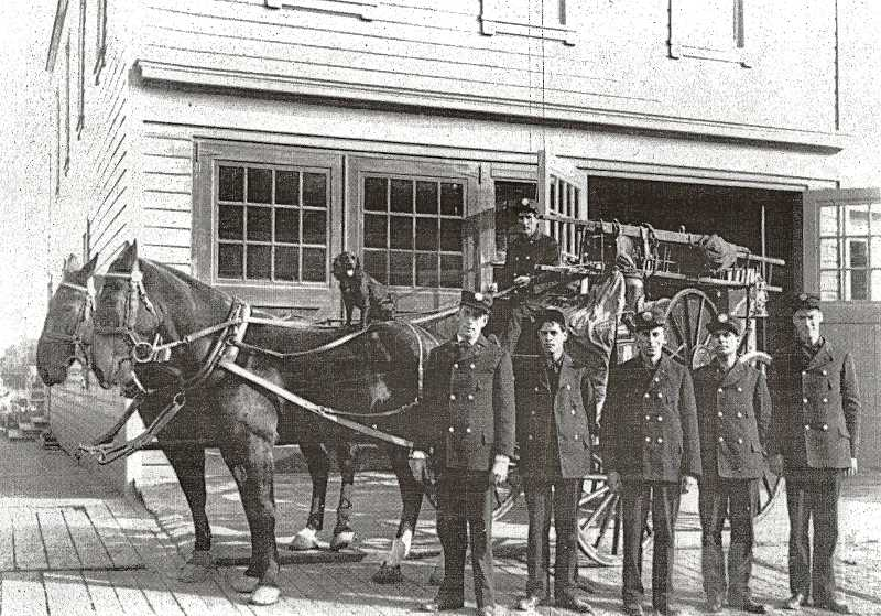 COURTESY OREGON HISTORICAL SOCIETY - The introduction of firefighting horses at the Sellwood fire station greatly improved the speed with which the fire brigade reached fires. It was in 1907 that the Sellwood Volunteer Firefighters were replaced with experienced professional firemen and well-trained horses. Here, Hose Company #4 poses outside of Sellwood Firehouse #20, with a black spaniel on board as a companion. The double folding doors had by then replaced the bay doors of the original station, built in 1896.