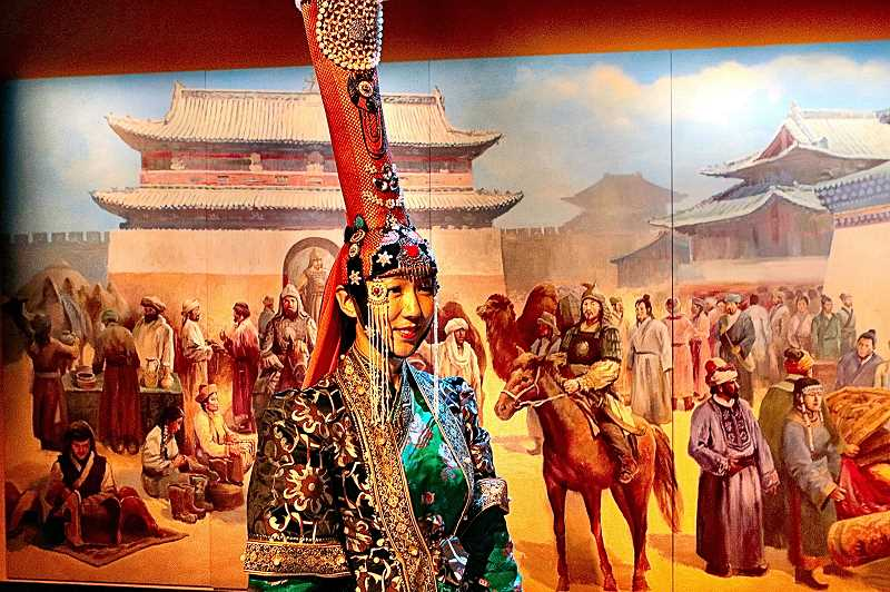 DAVID F. ASHTON - Wearing a traditional Mongolian gown and headdress, Uyanga Gankhuyag is one of three Mongolian musicians performing at the Genghis Kahn exhibition.