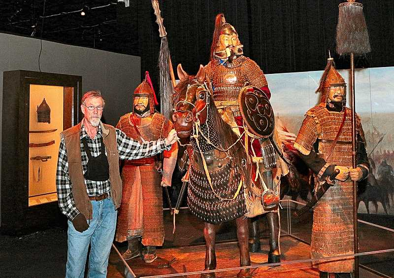 DAVID F. ASHTON - Traveling Exhibition Curator Francis Boid, an arms and armor collector, stands at a scene depicting how Genghis Khans army would have looked, as they approached a battlefield.
