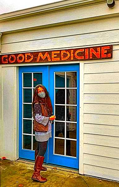 BECKY LUENING - Judi Martin emerges from Good Medicine Variety Shows virtual theater space, an extension of her new consignment store, Uplifted Boutique and Makers Market at S.E. 72nd and Harold Street. The sign you see was hand-carved by her partner in the business, husband David Argast.
