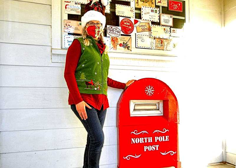ELIZABETH USSHER GROFF - Santas Elf, at left; and the North Pole Letterbox, at right. This picture was taken on the south side of All Saints Episcopal Church in Woodstock. All Inner Southeast children are invited to deposit letters to Santa into the big red letterbox.