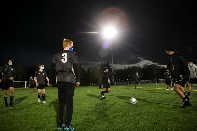 PMG PHOTO: JAIME VALDEZ - Players with Hillsboro Soccer Club prepare for a scrimmage at 53rd Avenue Community Park in Hillsboro on Dec. 3.