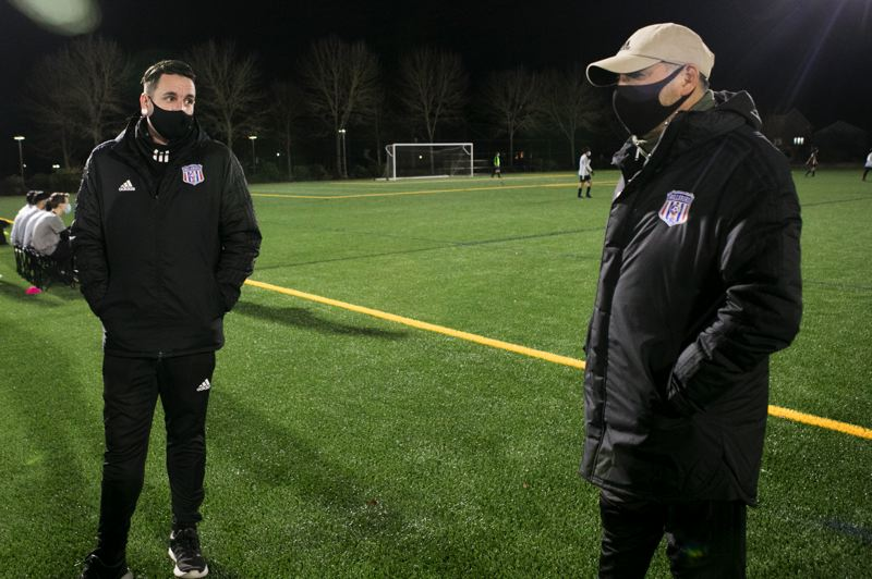 PMG PHOTO: JAIME VALDEZ - Mike Wall, left, assistant director of coaches for Hillsboro Soccer Club, and Oscar Monteblanco, director of coaches, at 53rd Avenue Community Park during a scrimmage Dec. 3.