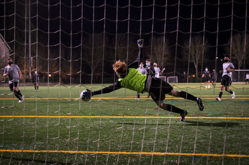PMG PHOTO: JAIME VALDEZ - Nicholas Lernon, 15, makes a save during a Hillsboro Soccer Club scrimmage at 53rd Avenue Community Park in Hillsboro on Dec. 3.