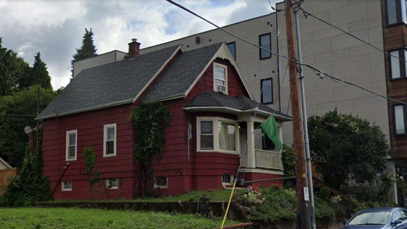 VIA GOOGLE MAPS - The Kinney family say they are one of few remaining Black families in this stretch of North Portland. Their 'Red House' on Mississippi Avenue was foreclosed upon and sold at auction.