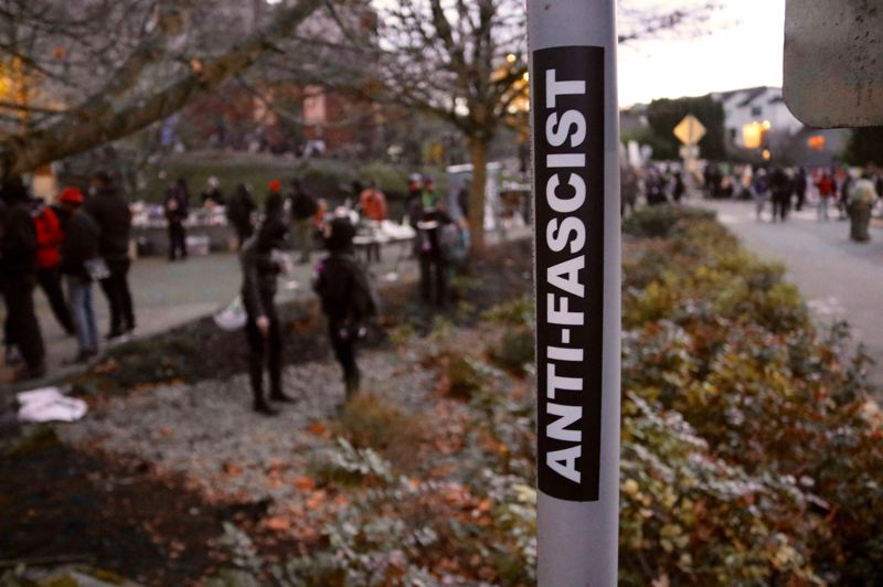 PMG PHOTO: ZANE SPARLING - A sticker with the word 'anti-fascist' was fastened to a pole near the 'Red House' on Mississippi Avenue in North Portland on Dec. 8.