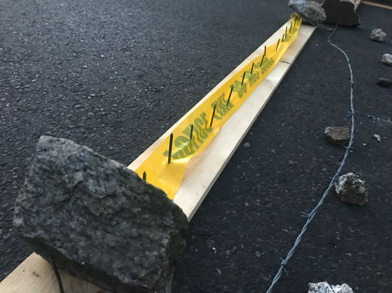 PMG PHOTO: ZANE SPARLING - Spike strips were deployed by protesters for an eviction blockade protecting the 'Red House' on  Mississippi Avenue in North Portland.