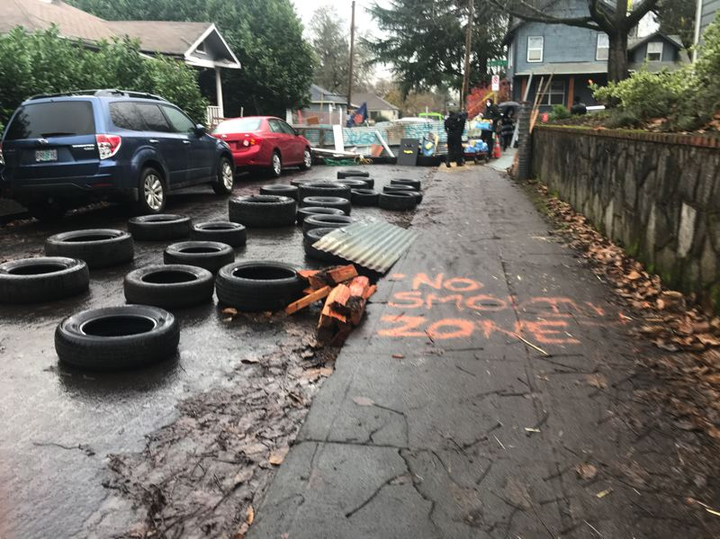 PMG PHOTO: ZANE SPARLING - A barricade was built near the Red House on Mississippi Avenue in North Portland on Dec. 9.
