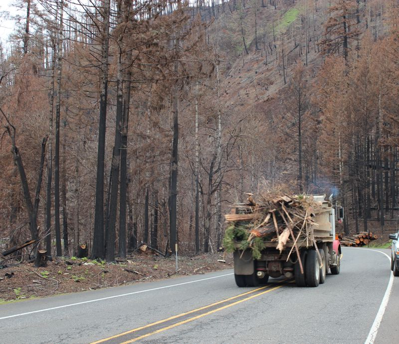 COURTESY PHOTO: U.S. FOREST SERVICE - A truck carries debris along Highway 224 in the aftermath of the Riverside Fire.