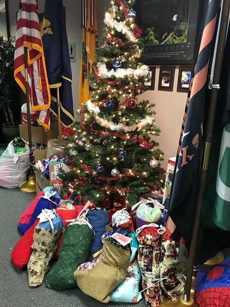 COURTESY PHOTO - Fort Kennedy has piled up donations for low-income veterans next to its Christmas tree in Clackamas County, but is looking for support to help 250 families.