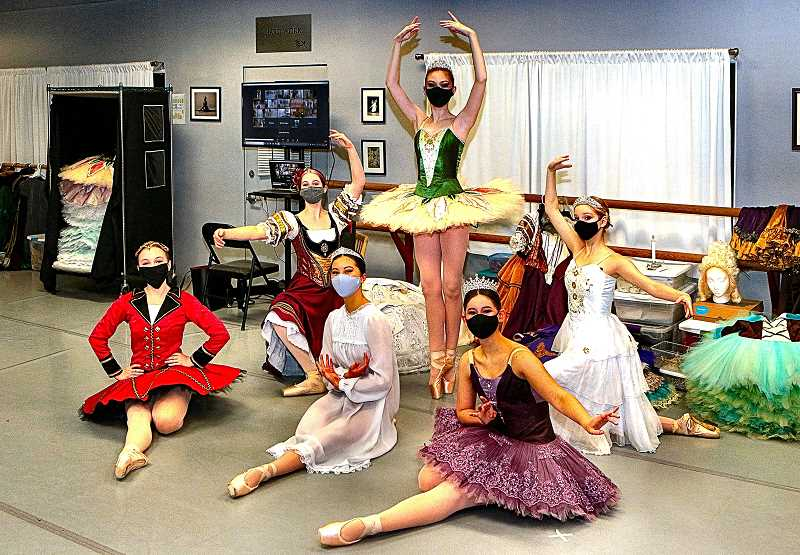 DAVID F. ASHTON - After trying their costumes for the December 12th outdoor presentation of Nutcracker Vignettes, Classical Ballet Academy dancers posed for THE BEE: [back row] Tea Cake, Chloe Block; Dew Drop Fairy, Lucy Holcomb; and Snow Ball Cookie, Kandis Gomes; along with [front row] The Nutcracker, Eloisa Ribbing; Clara, the ballets main female character, Issa Ono; and Sugar Plum Fairy, Anna Stiffler.