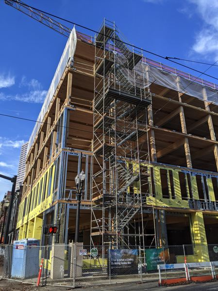 PAMPLIN MEDIA GROUP: JOSEPH GALLIVAN  - The PAE Living Building behind the Pine Street Market food hall and Kell's Irish Pub in downtown Portland will be built to Living Building standard and is being constructed with cross-laminated timber panels and glulam columns.