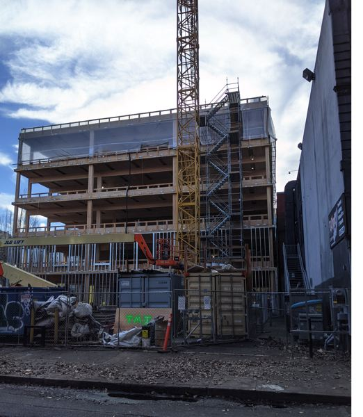 PAMPLIN MEDIA GROUP: JOSEPH GALLIVAN  - The PAE Living Building behind the Pine Street Market food hall and Kell's Irish pub (white wall at right) in downtown Portland will be built to Living Building standard, the hardest benchmark to achieve in energy efficiency.