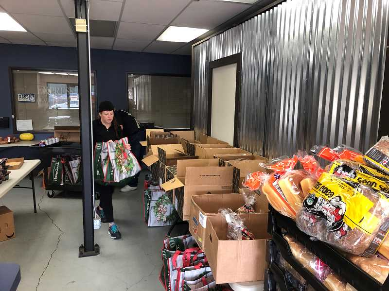COURTESY PHOTO - Genie Beers volunteers for Fort Kennedy packing boxes of food for low-income veterans in the Portland area.