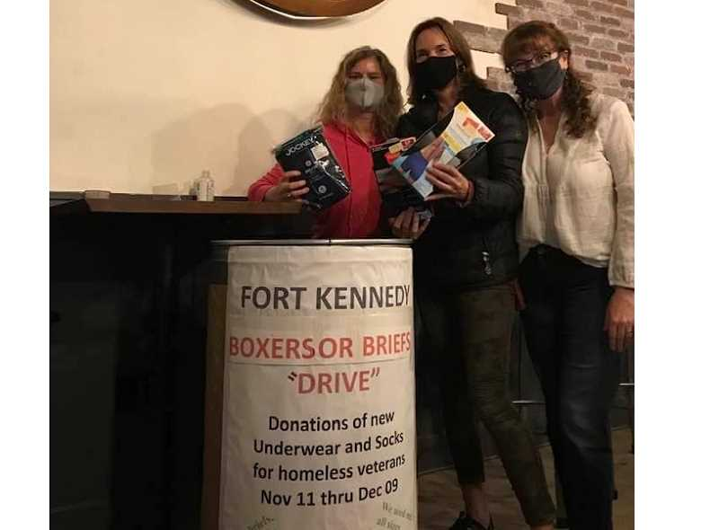 COURTESY PHOTO - Jennifer Aburg, Nicole Budden and Nicole Mitchell stand next to a barrel accepting donations of socks and boxers for Fort Kennedy's veteran beneficiaries.