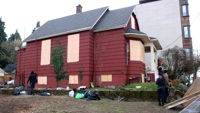 PMG PHOTO: ZANE SPARLING - An eviction blockade effort sprung up around the Red House on Mississippi Avenue in North Portland on Tuesday, Dec. 8.