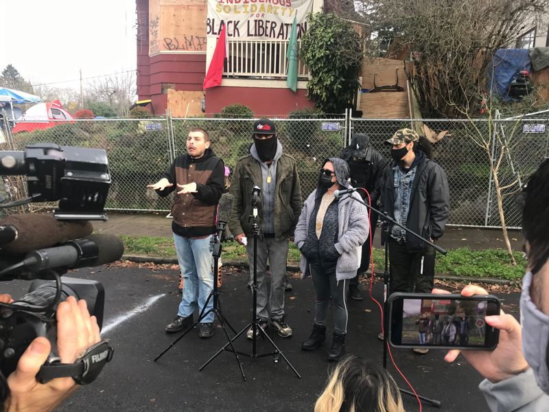 PMG PHOTO: ZANE SPARLING - William Kinney III, who uses the name William X. Nietzche, speaks with reporters during a press conference outside the Red House on Wednesday, Dec. 9.