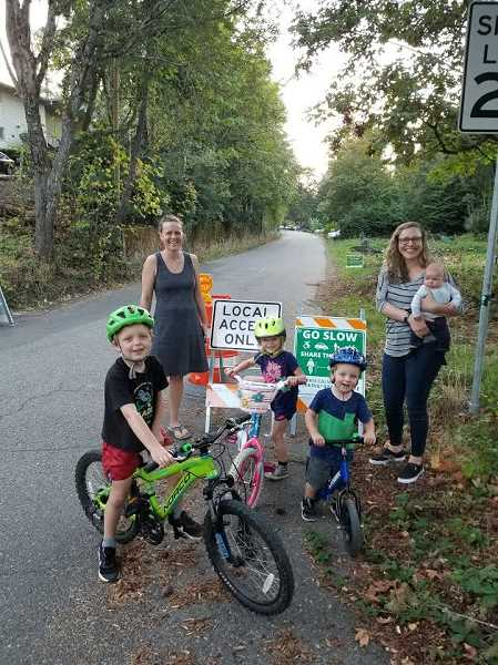 SW TRAILS PDX - Moms and kids who live and play on Southwest Bertha Boulevard are fans of the effort to keep unwelcome cars and trucks off their street with Local Access Only signs.