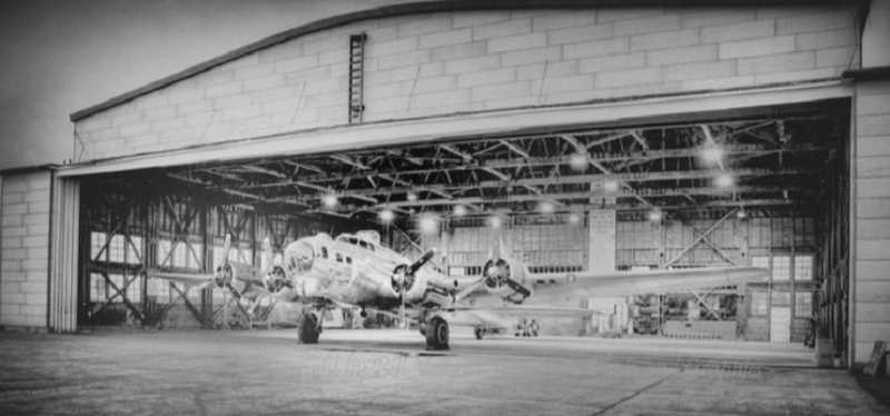 PHOTO COURTESY OF BOWMAN MUSEUM  - A B-17 bomber rests inside a WWII hangar at Madras Air Base.