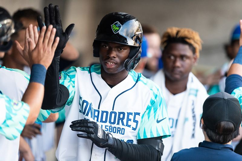 PMG FILE PHOTO - Hillsboro Hops outfielder Kristian Robinson celebrates hitting a home run against the Salem-Keizer Volcanoes on July 23, 2019. The Hops will remain a minor league affiliate in 2021, but the Volcanoes have been dropped from the league.