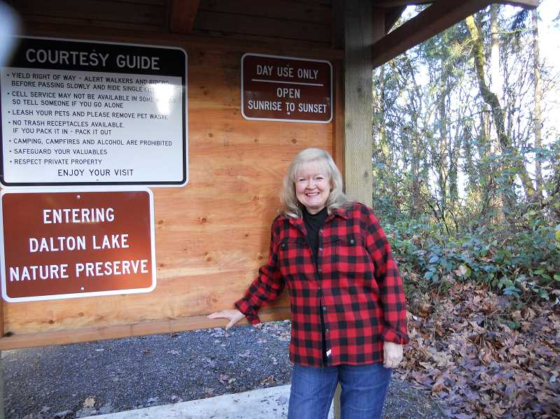 PMG PHOTO: SCOTT KEITH - Lynne Pettit stands in front of the kiosk at the Dalton Lake Nature Preserve.