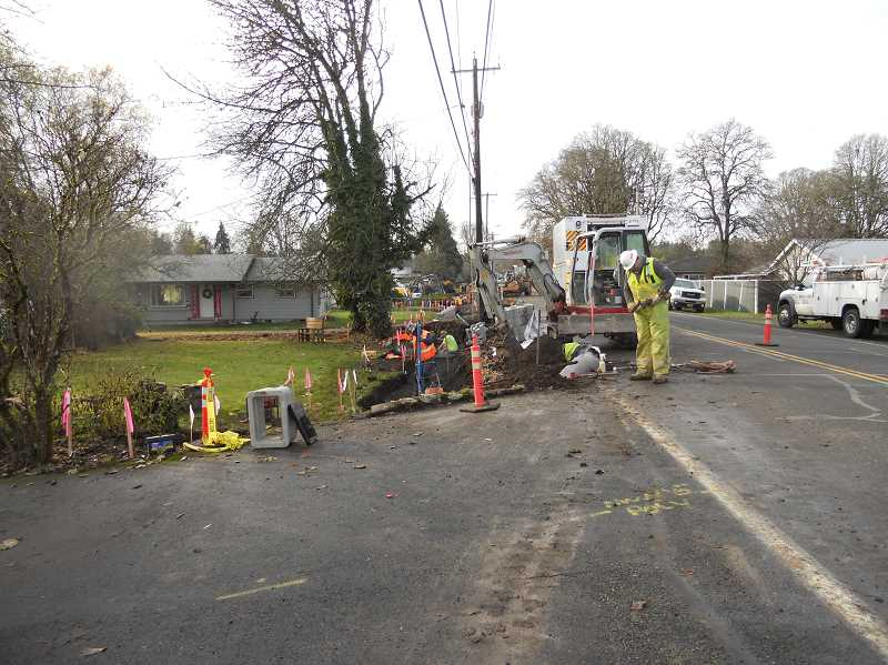 PMG PHOTO: SCOTT KEITH - Crews from Northwest Natural Gas are helping out during the sidewalk project in St. Helens.