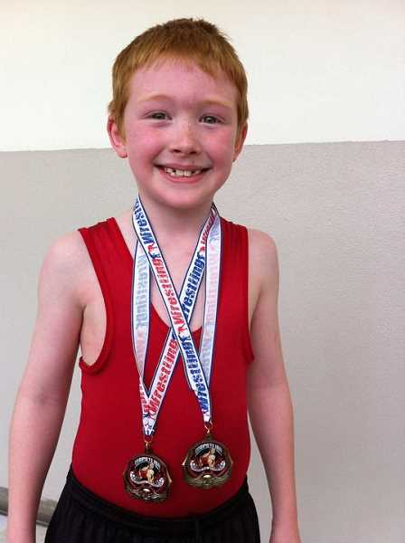 SUBMITTED PHOTO - Ever since he was 8 years old, Abram Nelson, shown here in 2001 as a member of the Sherwood Mat Club, has wanted to start a wrestling club at Linfield University.