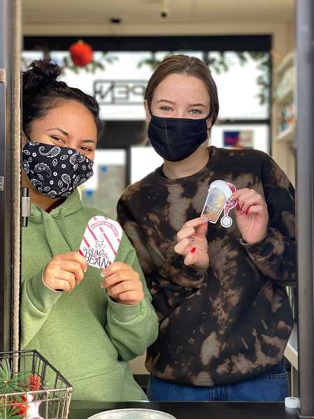 PHOTO COURTESY OF AMBER SEARCY   - The Human Bean elves Sydney Shimaoka, left, and Kylee Abendschein show free coffee cards that were donated to Operation Rudolph for local teens.
