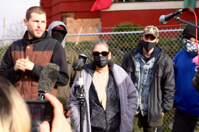 PMG PHOTO: ZANE SPARLING - Members of the Red House family, including Julie Metcalf Kinney, center, and brothers William and Michael Kinney, speak during a press conference in North Portland.
