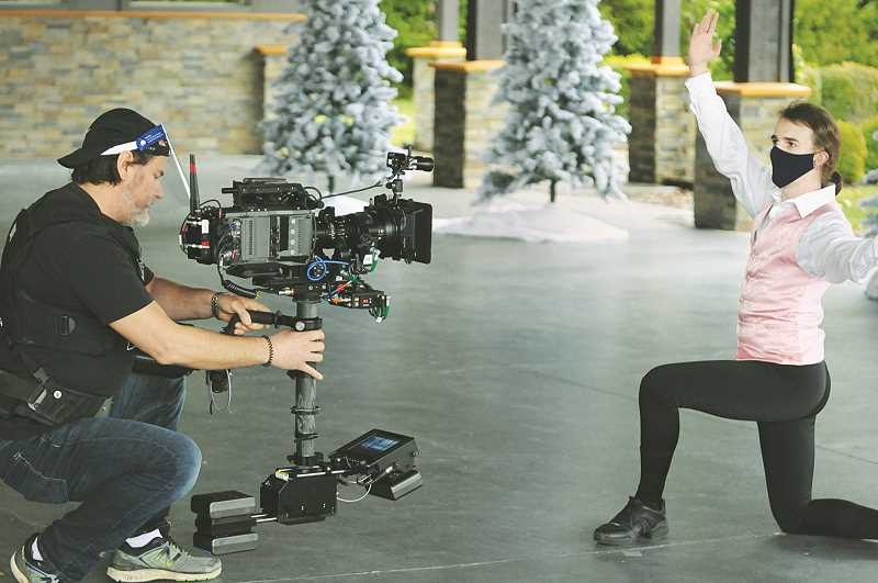 PMG PHOTO: GARY ALLEN - Matt Moriarty, director of photography for the Camden Picture Company, photographs CVDA dancer Jamie Burgess during filming on Dec. 13.