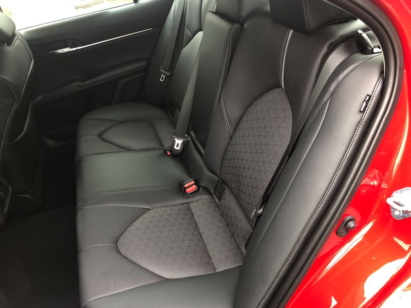 PMG PHOTO: JEFF ZURSCHMEIDE - The rear seat of the 2021 Toyota Camry offers enough room for three adults.