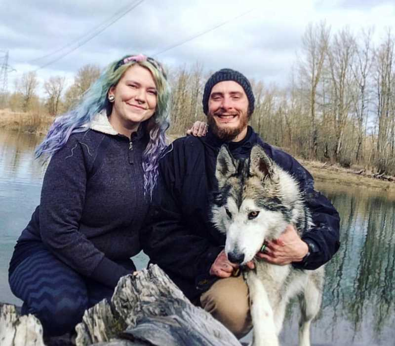 COURTESY PHOTO: LANEA KOLLENBURN - Lanea and Caleb Kollenburn pose for a picture with their service dog and beloved pet, Lladk.