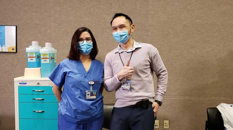 COURTESY PHOTO: LEGACY HEALTH SYSTEMS - Mayra Gomez, an ICU nurse at Legacy Emanuel Medical Center and Dr. Dominic Chan both received some of the first doses of the new COVID-19 vaccine Wednesday, Dec. 16.