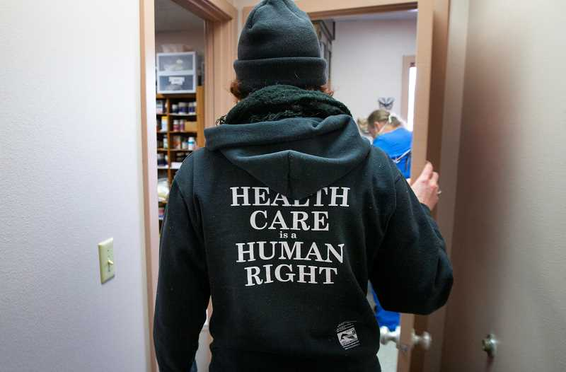 COURTESY PHOTO: REGISTER-GUARD - Occupy Medical team leader MacKenzie Ni Flainn walks down the hallway of the clinic in Springfield.