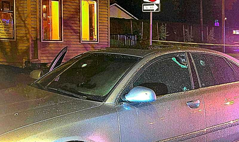 COURTESY PORTLAND POLICE BUREAU - Despite the heavy rain falling at the time, this car obviously received a number of bullet strikes on Powell Boulevard at 68th.