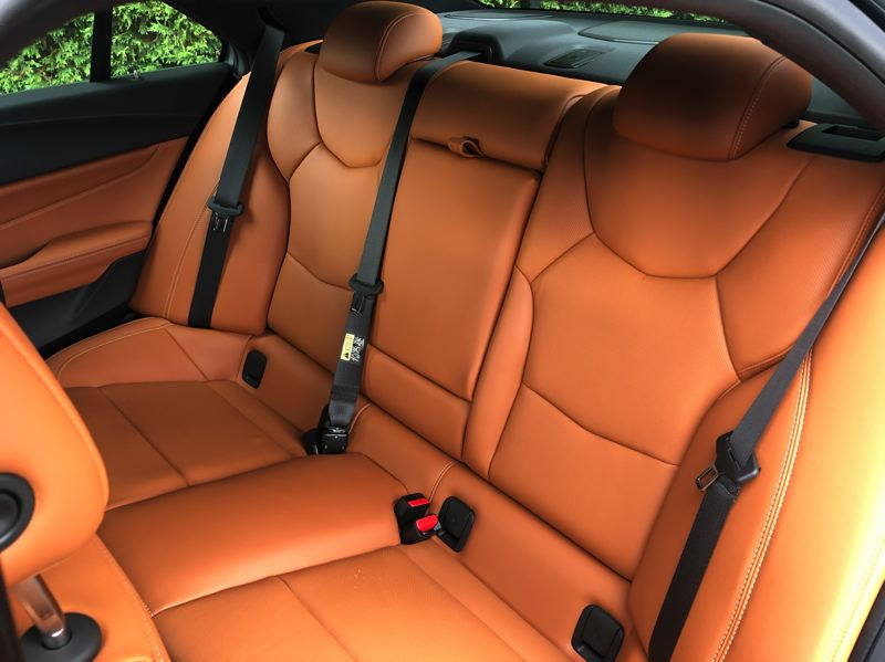 PMG PHOTO: JEFF ZURSCHMEIDE - The rear seats in the 2021 Cadillac CT4 are roomy enough for three adults.