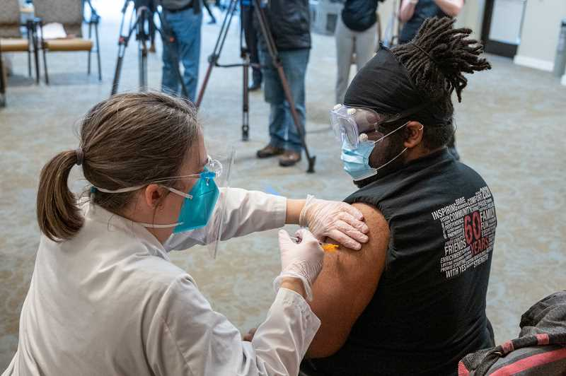 COURTESY PHOTO - Rose Villa staff member John Eaglin gets vaccinated against COVID-19 on Dec. 21.