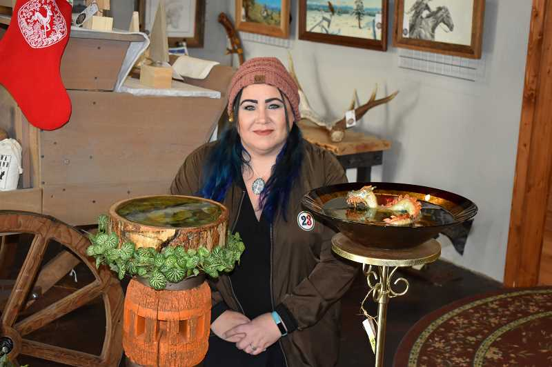 RAMONA MCCALLISTER - Diana Krugle proudly displays some of her larger art pieces in the showroom of Rick Steber & Company-Makers.