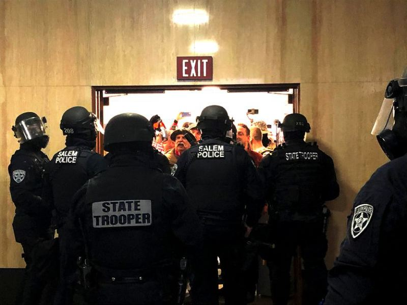 COURTESY PHOTO: OPB - Protesters opposed to the state's COVID-19 provisions protest at the state Capitol on Monday. The protests included property damage, trespassing and assault on reporters.