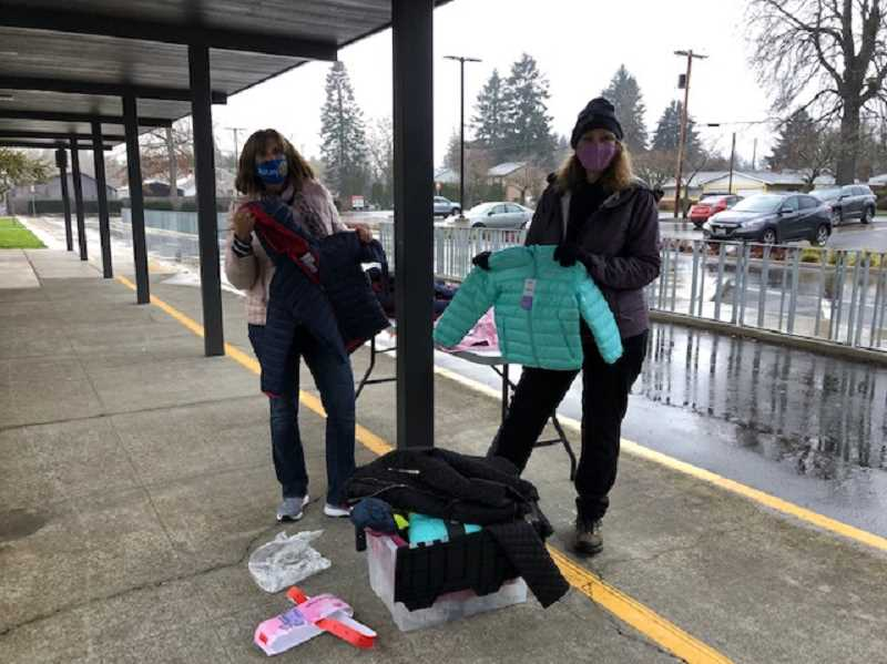 COURTESY PHOTO - Rotary Club members Renee Taylor and Kathy Harrison gave away coats to families at Lot Whitcomb Elementary, partnering with Clackamas Service Center.